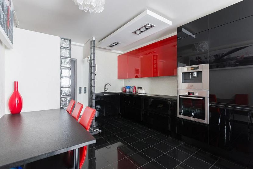 Kitchen with white walls and a red accent